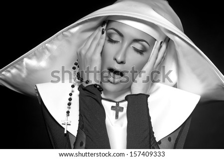 Sexy nun. Black-and-white photo.