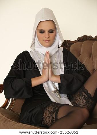 Sexy nun praying - stock photo