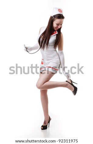 sexy nurse in a white coat with a stethoscope. Isolation of a white background.