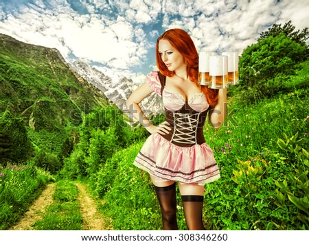 Sexy oktoberfest young beautiful woman wearing a dirndl with 3 froth beer mugs isolated on alpine meadow near mountains outdoor - stock photo