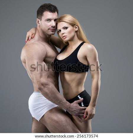 Sexy pair of athletic people - stock photo