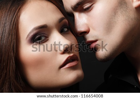 Sexy passion couple, beautiful young female and male faces closeup, studio shot - stock photo