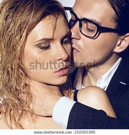 Sexy passion couple, beautiful young man and woman closeup, studio shot  - stock photo