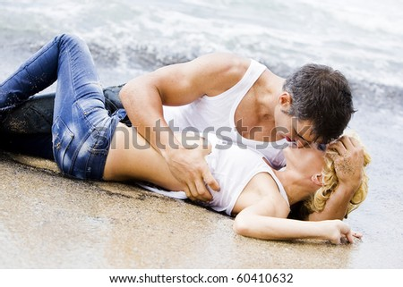 sexy passionate couple showing their affection during a sexual foreplay - stock photo