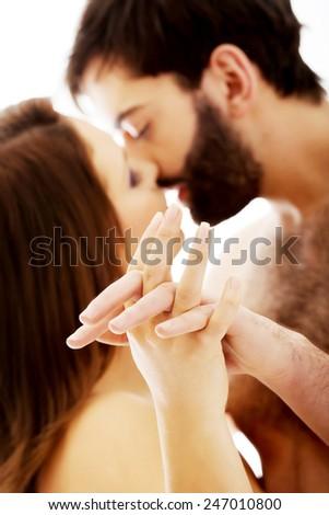 Sexy passionate heterosexual couple kissing. - stock photo
