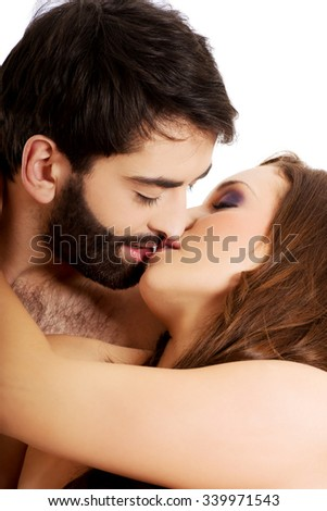 Sexy passionate heterosexual couple kissing.