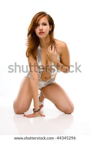 sexy pin-up girl in silver bathing suit kneeling