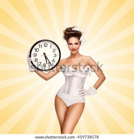 Sexy pinup bride in a vintage wedding corset holding an office wall clock and showing the time on colorful abstract cartoon style background. - stock photo