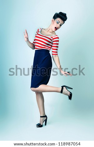 sexy pinup woman in striped t-shirt and black shoes - stock photo
