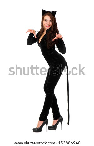 Sexy playful woman posing in black catsuit. Isolated on white. - stock photo
