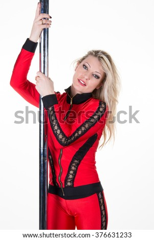 Sexy pole dancer practice, isolated on a white background