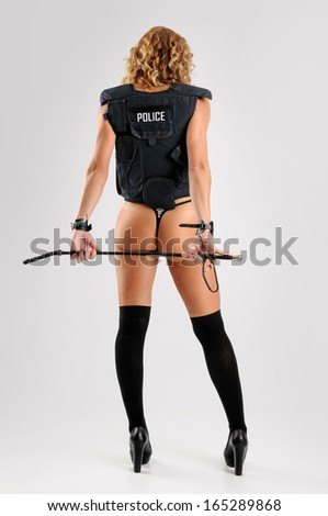 Sexy police woman with bulletproof vest - stock photo