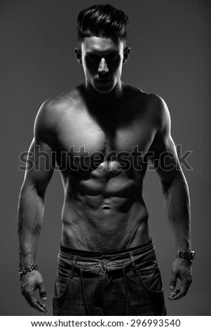 Sexy portrait of a very muscular male model in sensual pose.