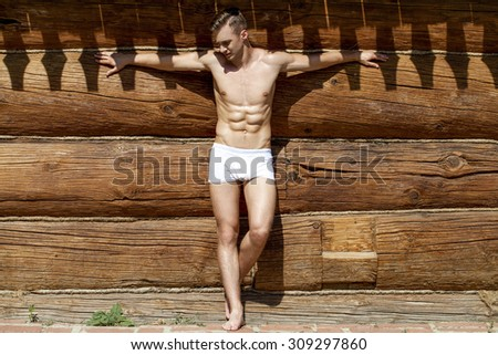Sexy portrait of a very muscular shirtless male model  - stock photo