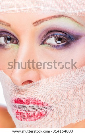 sexy portrait of a woman in a gauze bandage