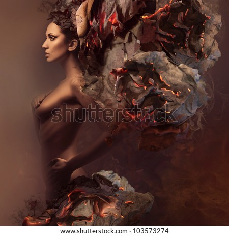 sexy pretty woman in burning paper - stock photo