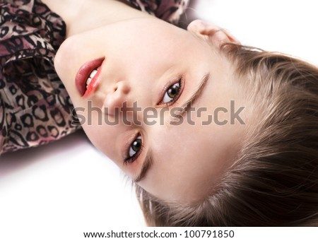 Sexy pretty woman lying on the floor, close up - stock photo