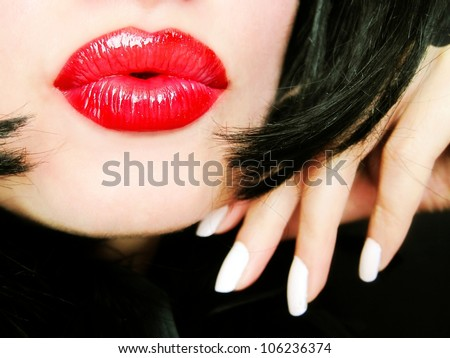 Sexy pretty woman with red lips sending a kiss / smooch - closeup - stock photo