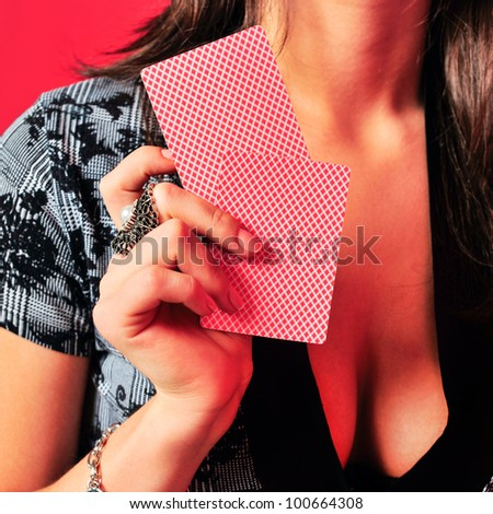 Sexy provocative  woman with playing cards at nightclub - stock photo