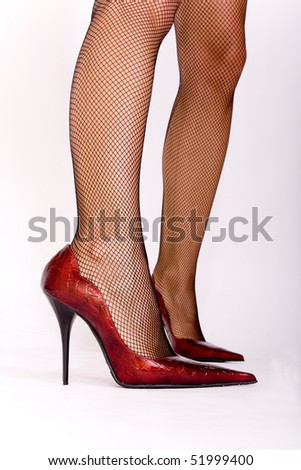 Sexy red shoes on sexy legs