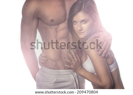 Sexy Romantic Couple on Haze Portrait. Emphasizing Seductive Woman While Touching Sexy Partner. - stock photo