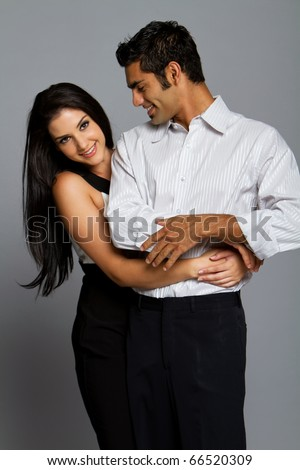 Sexy romantic young couple in suit - stock photo