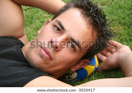 Sexy rugby player with ball - stock photo