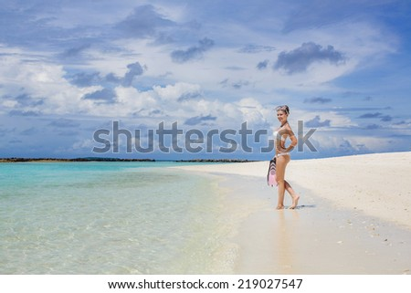 Sexy sandy woman with snorkeling equipment on the beach background. Happy woman with snorkeling equipment on the beach Fun woman with snorkeling equipment on the beach