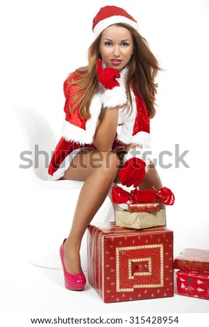 Sexy santa claus woman with christmas pack - stock photo