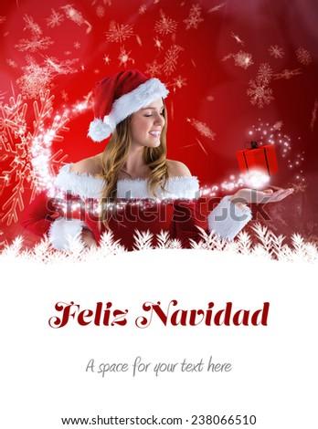 sexy santa girl presenting with hand against feliz navidad - stock photo
