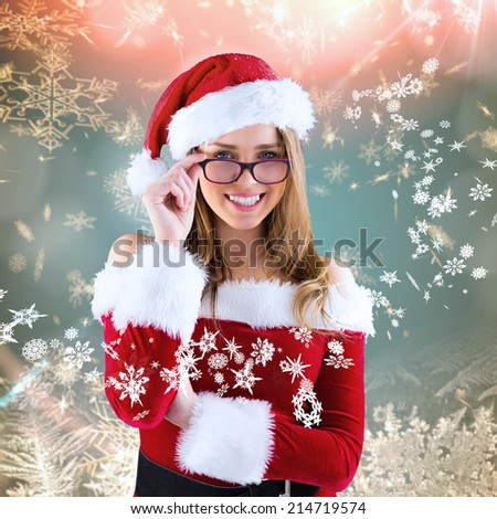 Sexy santa girl wearing spectacles against cream snow flake pattern design - stock photo