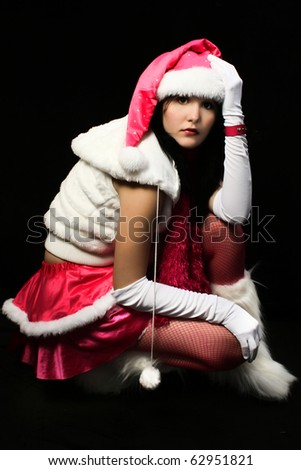 Sexy santa's helper in pink and white over dark background.