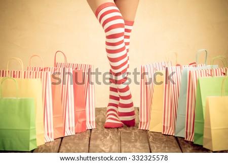 Sexy Santa woman legs. Christmas shopping concept - stock photo
