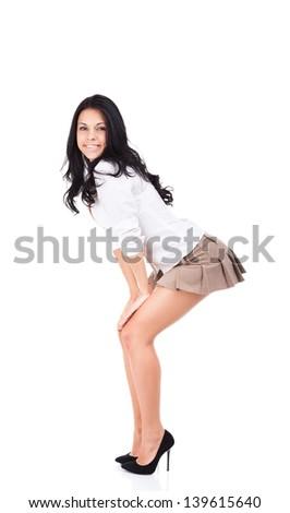 sexy school student girl in short skirt, hot brunette curly hair woman long legs high heel, full length portrait isolated over white background - stock photo