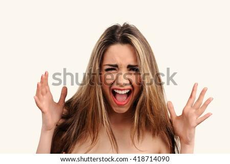 Sexy screams girl with white teeth - stock photo