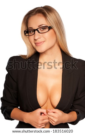 Sexy secretary. Attractive young blond hair woman with beautiful cleavage taking off her jacket and smiling while standing isolated on white  - stock photo