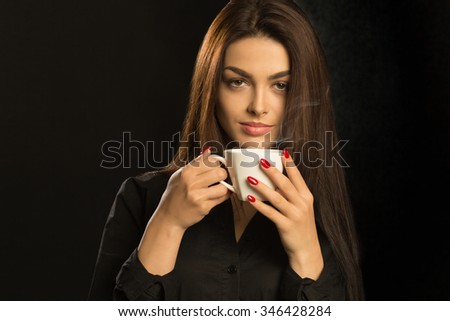 Sexy sensual woman in black blouse drink coffee - stock photo