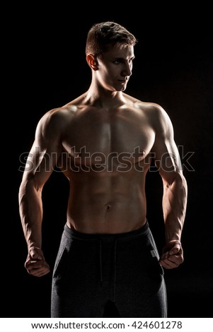 Sexy shirtless bodybuilder posing,