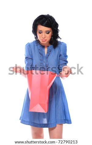 Sexy shopping girl holding colorful bag isolated over white background - stock photo