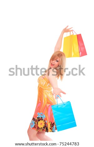 Sexy shopping girl holding colorful bags  isolated on white background