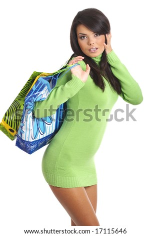 Sexy shopping girl. Isolated over white background - stock photo