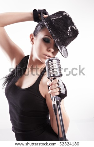 Sexy singer girl singing and dancing - stock photo