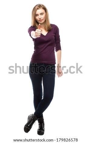 Sexy slender attractive young woman giving a thumbs up gesture of success and approval, full length isolated on white