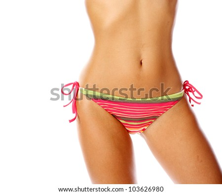 Sexy slim belly isolated on white background - stock photo