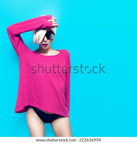 Sexy Slim Blonde Girl on blue background. Party fashion style - stock photo