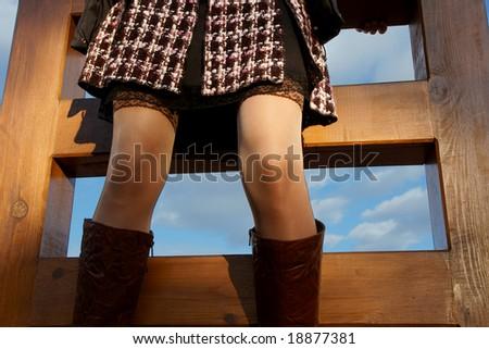 sexy slim knees on the stairs to sky - stock photo