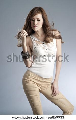 Sexy slim woman in fashion dress. - stock photo