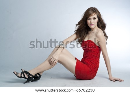 Sexy slim woman in red dress. - stock photo