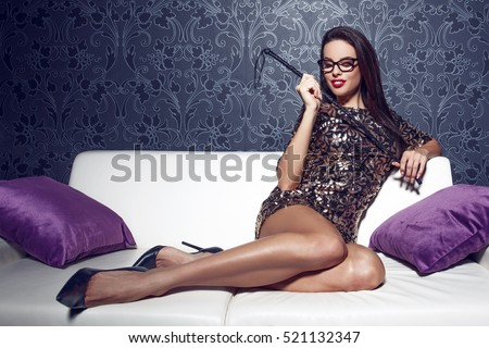 Sexy smart woman in glasses with whip, bdsm