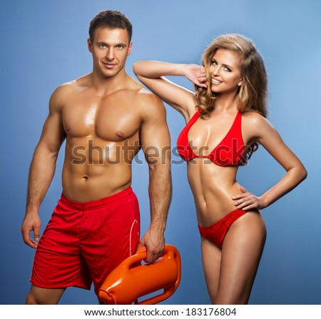 Sexy smile rescuers Of Water - stock photo